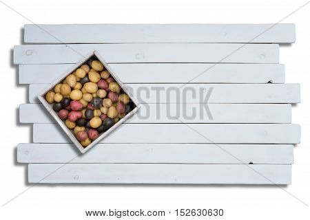 Colorful Potatoes In Box On Wooden Planks