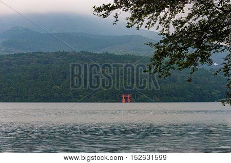 Red Torii Gate In Lake Water