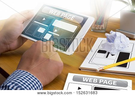 Web Design Template And  Web Page Closeup Shot Of Laptop With Digitaltablet And Smartphone On Desk.