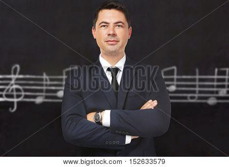 Portrait of teacher on chalkboard background