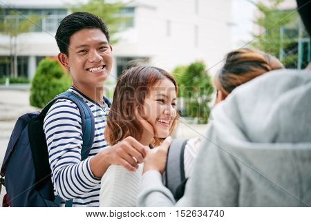 Vietnamese college student walking with his classmates
