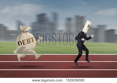 Anonymous entrepreneur running on the track while escaping from debt