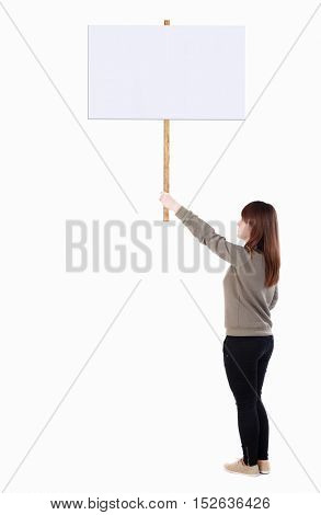 Back view woman showing sign board. man holds information plate. Rear view people collection. Isolated over white background. girl in a gray sweater holds in his right hand a poster on a pole.