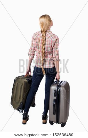 Back view woman with suitcase looking up. Standing young girl. Rear view people collection.  backside view Isolated over white background. Girl with very long hair suitcases site in hands looks upward