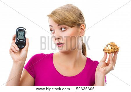 Shocked Woman Holding Glucometer And Fresh Cupcake, Measuring And Checking Sugar Level, Concept Of D