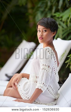 Portrait of attractive Indonesian woman in summer dress