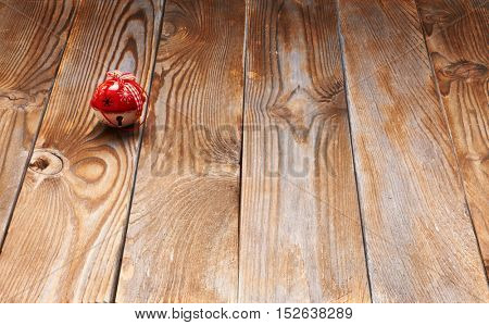 Christmas jingle bell decoration on wooden background