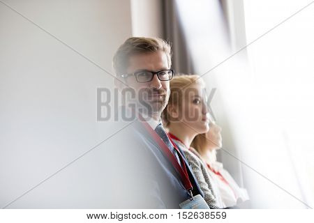 Man with glasses at Conference looking at the camera