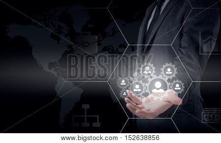 Hand carrying businessman icon network - HR, HRM, MLM, teamwork and leadership concept.