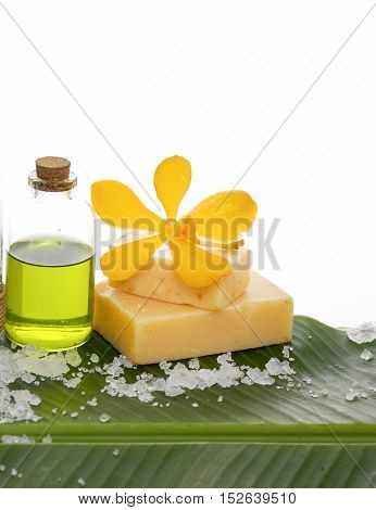Spa set on banana leaf with orchid on soap