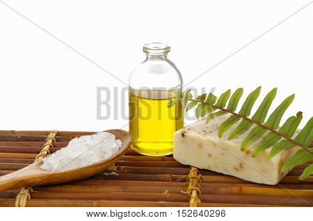 massage oil and ferm with Salt in spoon ,soap, on mat