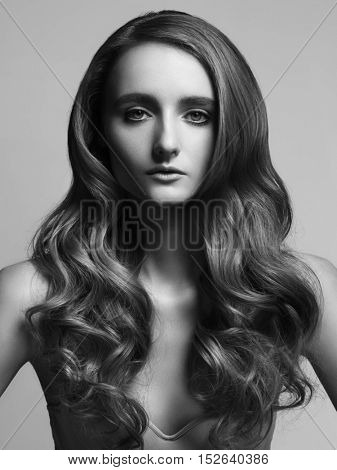 Beautiful Young Woman with Long Healthy and Shiny Smooth Hair. Healthcare and beauty concept