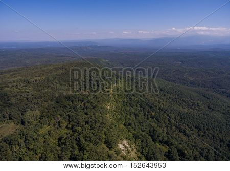 Aerial nature panorama. Hills covered with forest.