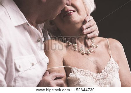 Senior Couple Kissing And Embracing