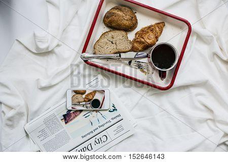 Coffee Americano Espresso Newspaper Breakfast in Bed Concept