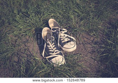 Vintage photo of sneakers in the grass