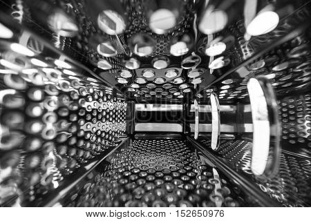 Grater for cheese. Inside view. Abstract surface. Close up / macro.