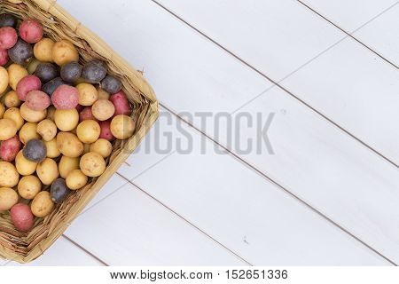 Wicker Basket Filled With Assorted Fresh Potatoes