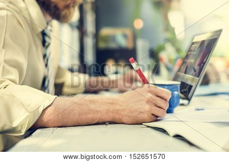 Businessman Writing Notebook Working Laptop Concept