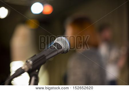 Microphone on a blurred background the people in the club