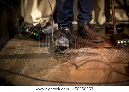 Feet Of The Musician On Stage, Guitar Processor, Column