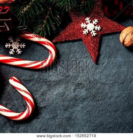 Christmas decorations on dark background vintage retro style. Winter Xmas card with stars bells balls and candies