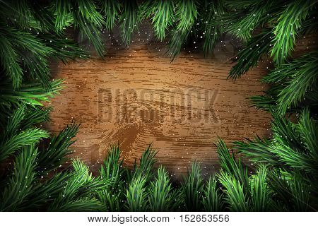 Christmas green pine wreath on brown wooden background
