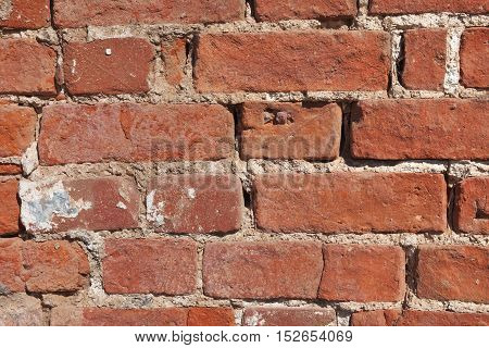 Fragment of old brick wall close up. Texture background