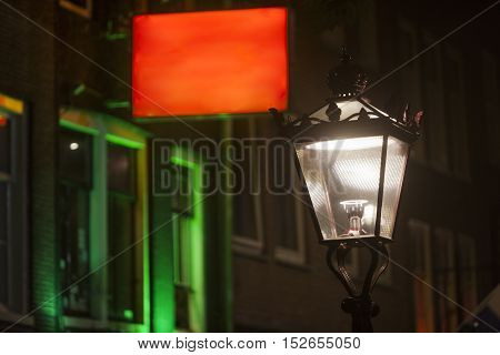 Lantern and red and green city lights in Amsterdam