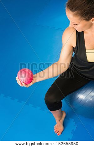 Woman working out with exercise ball, toned image