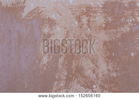 Image of a concrete wall in shades of brown, suitable for use as a background or texture.