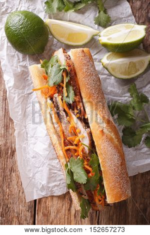 Vietnamese Pork Banh Mi Sandwich With Cilantro And Carrot Close-up. Vertical Top View