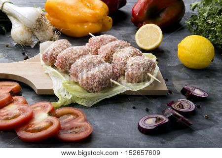 Composition Of Vegetables And Raw Meat Rolls To Bake