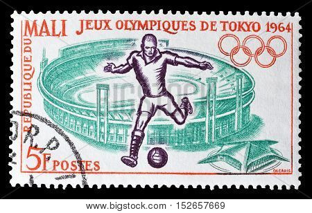 MALI - CIRCA 1964 : Cancelled postage stamp printed by Mali, that shows Stadium and football player.