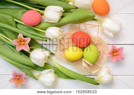 Easter Eggs and tulips on old white wood - Season Background Frame