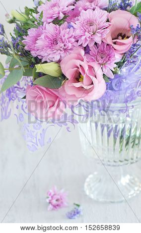 Lovely bunch of flowers in a vase on the table .