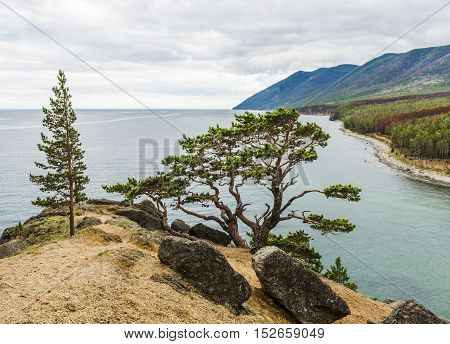 Scenic view from the high steep banks of the mountains and taiga around lake Baikal.