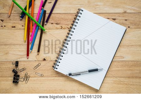 Flat lay blank open notebook and copy space. School supplies Top view.