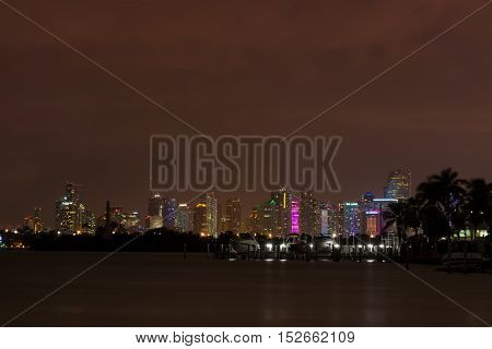 Long exposition night shot of Downtown Miami Florida seen from Miami Beach.