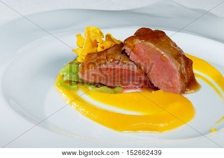 lamb chops with mashed pumpkin and  mixed vegetables