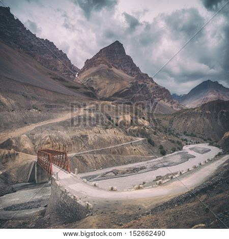 red bridge in himalayas mountain, toned like Instagram filter