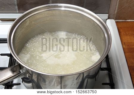 Saucepan Of Rice In Boiling Water On A Gas Hob