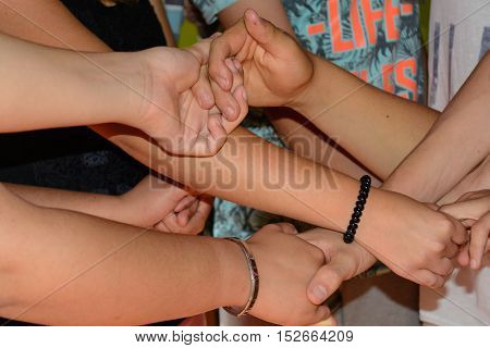 Many hands grasp trustingly other hands - close-up