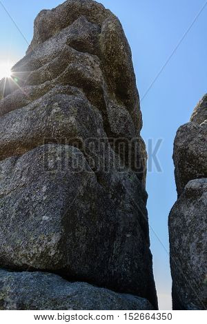 The sun is shining in giant boulders at Dreisesselberg