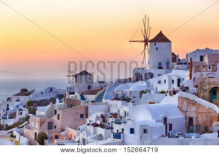 Beautiful Oia village at sunset in Santorini island photographed from a high point of view in HDR.