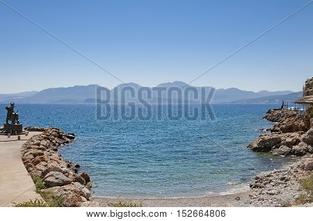 A dramatic view of a mountain range from across the water on the greek island of crete.