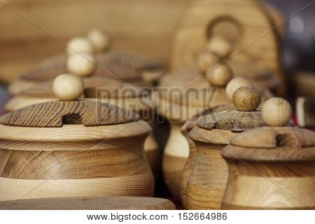 Handmade latvian wood dishes with caps at market