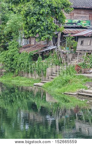 Old run down River shacks in Phetchaburi Thailand.