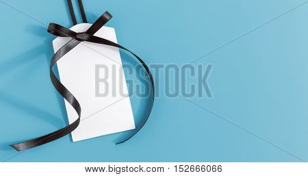 White Tag With Black Ribbon