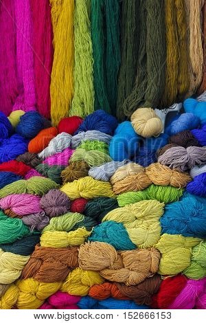 Different colour sheep wool yarns at market